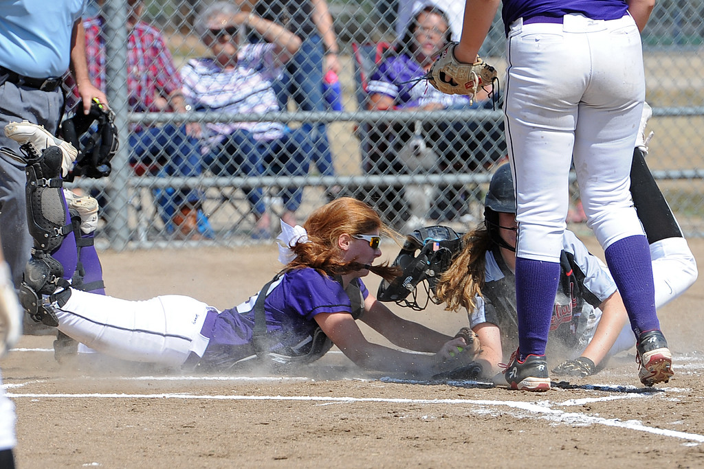 . Loveland\'s Allison Westbrook slides home ahead of the tag by Mountain View catcher Nicole Rogers during a game Saturday, Sept. 8, 2018 at Mountain View High School in Loveland. (Sean Star/Loveland Reporter-Herald)