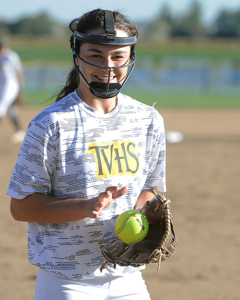 Thompson Valley's Makenna McVay grabs a foul ball from catcher Autumn Porter during their game Thursday, Oct. 4, 2018 at Mountain View High School. (Sean Star/Loveland Reporter-Herald)
