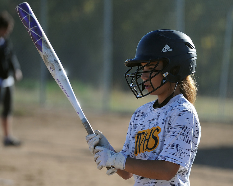 Thompson Valley's Elizabeth Texeira steps out of the batter's box during a game Thursday, Oct. 4, 2018 at Mountain View High School. (Sean Star/Loveland Reporter-Herald)