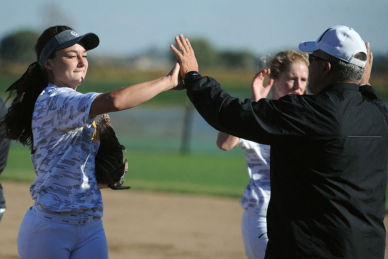 Thompson Valley's Makenna McVay high-fives coach Bryon Rutherford during their game Thursday, Oct. 4, 2018 at Mountain View High School. (Sean Star/Loveland Reporter-Herald)
