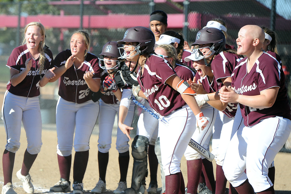 . Berthoud teammates cheer for Sophie Supernor as she heads home after hitting a home run during the first day of the 4A state softball tournament on Friday, Oct. 19, 2018 at Aurora Sports Park. (Sean Star/Loveland Reporter-Herald)