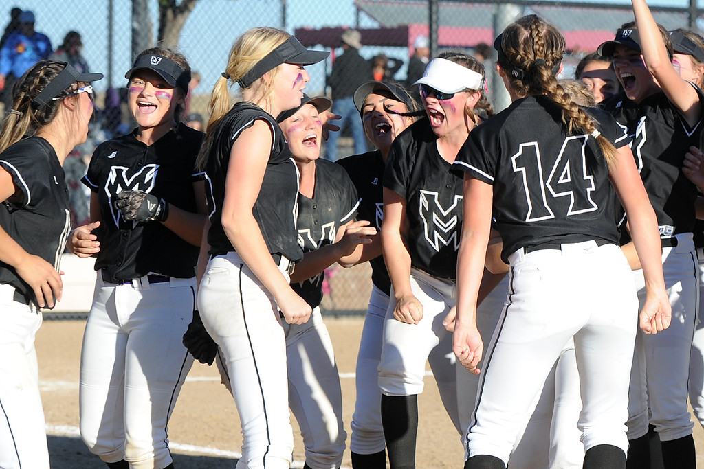 . Mountain View celebrates its win over Golden during the first day of the 4A state softball tournament on Friday, Oct. 19, 2018 at Aurora Sports Park. (Sean Star/Loveland Reporter-Herald)