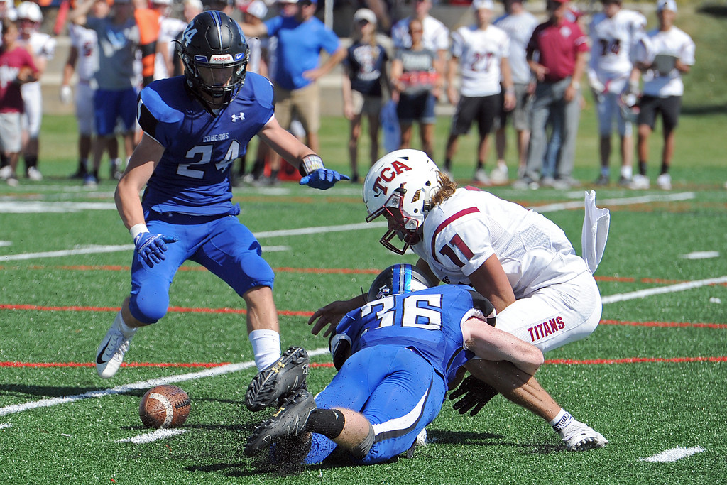 . Resurrection Christian\'s Evan King tackles punter Ethan Boyles as RCS\' Tanner Applebee goes to recover the loose ball during a game against The Classical Academy on Saturday, Sept. 15, 2018 at Loveland Sports Park. (Sean Star/Loveland Reporter-Herald)