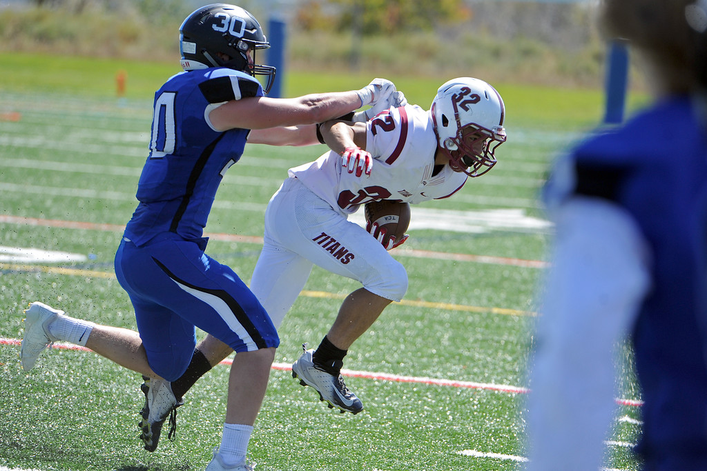 . Resurrection Christian\'s Kyle Lueck shoves Andrew Santos to the ground during a game against The Classical Academy on Saturday, Sept. 15, 2018 at Loveland Sports Park. (Sean Star/Loveland Reporter-Herald)
