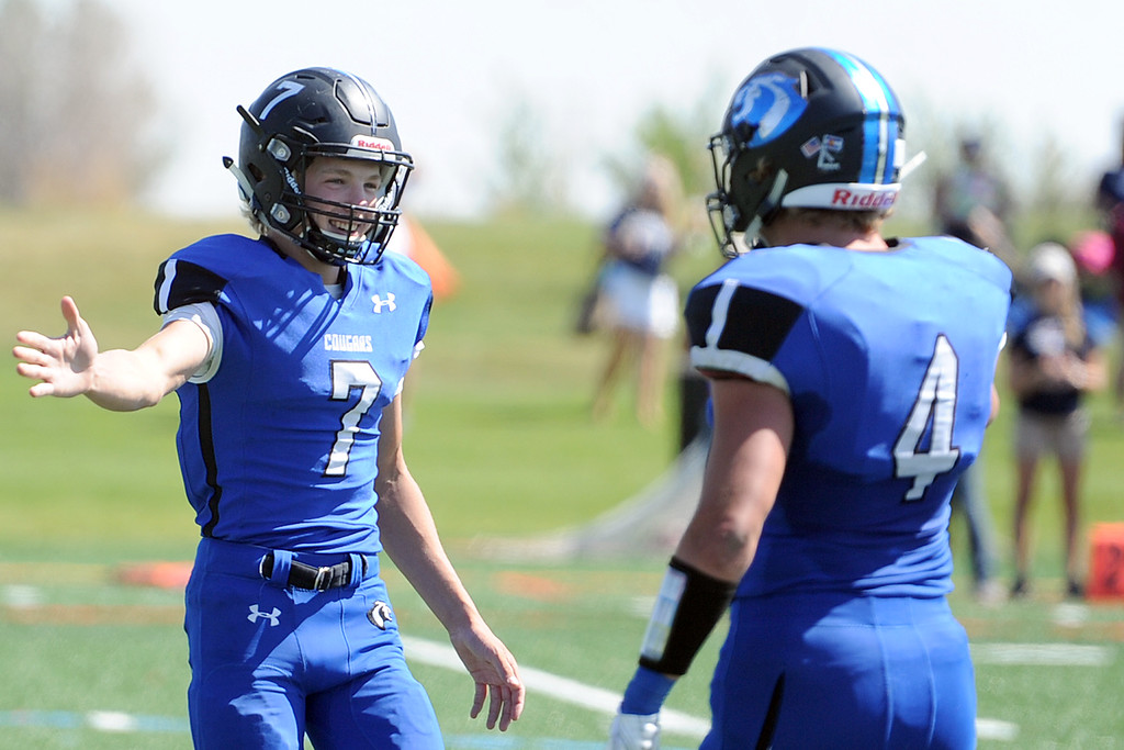 . Resurrection Christian\'s Buck Coors (7) high-fives Zane Zuhlke during a game against The Classical Academy on Saturday, Sept. 15, 2018 at Loveland Sports Park. (Sean Star/Loveland Reporter-Herald)