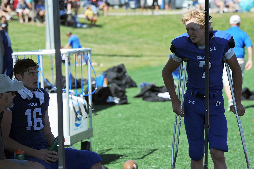 . Resurrection Christian starting quarterback Buck Coors (7) and backup Isaac Crane (16) both rest on the sideline during a game against The Classical Academy on Saturday, Sept. 15, 2018 at Loveland Sports Park. (Sean Star/Loveland Reporter-Herald)