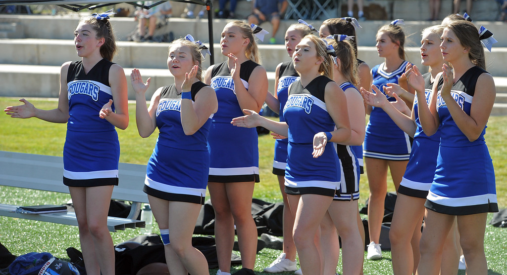 . Resurrection Christian cheerleaders applaud the Cougars after a game against The Classical Academy on Saturday, Sept. 15, 2018 at Loveland Sports Park. (Sean Star/Loveland Reporter-Herald)