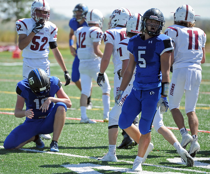 Resurrection Christian's Isaac Crane, left, and Jackson Lovette (5) hang their heads in frustration after a turnover during a game against The Classical Academy on Saturday, Sept. 15, 2018 at Loveland Sports Park. (Sean Star/Loveland Reporter-Herald)