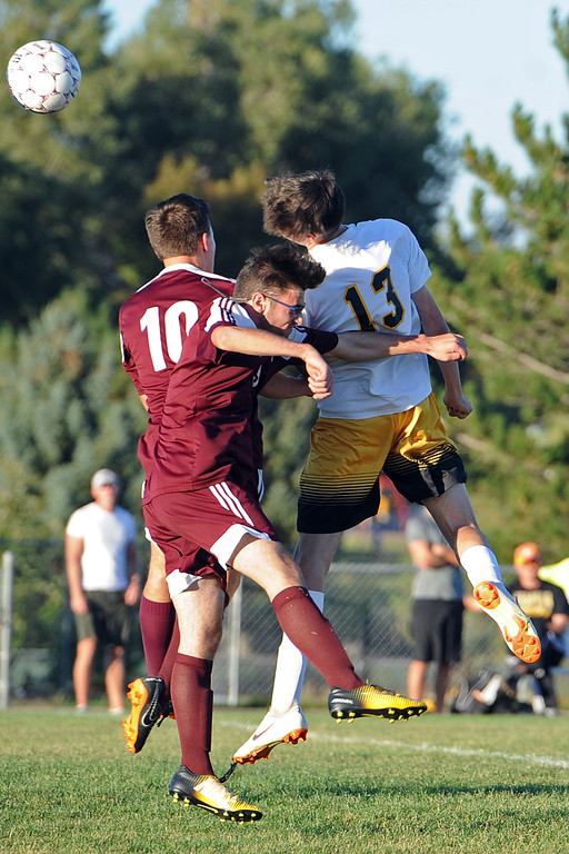 . Thompson Valley\'s Ian Levin (13) skies for a header next to Berthoud\'s Caden Grimditch and Sergey Eggers during a game Thursday, Sept. 20, 2018 at Berthoud High School. (Sean Star/Loveland Reporter-Herald)