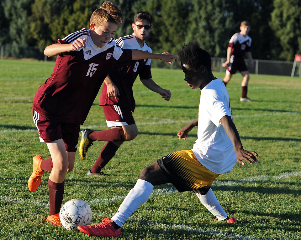 . Berthoud\'s Ashton Scaggs (15) battles for possession with Thompson Valley\'s Junio Lang during a game Thursday, Sept. 20, 2018 at Berthoud High School. (Sean Star/Loveland Reporter-Herald)