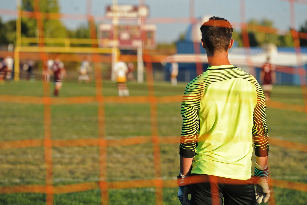 . Berthoud\'s Kellan Marks watches the action from his own goal during a game Thursday, Sept. 20, 2018 at Berthoud High School. (Sean Star/Loveland Reporter-Herald)