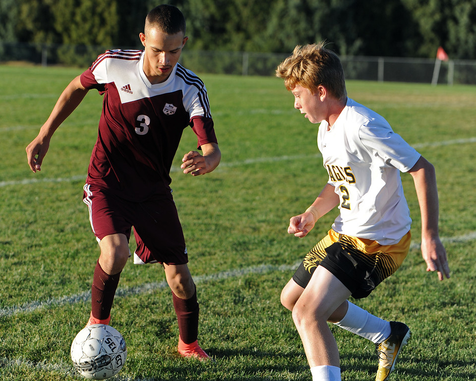 . Berthoud\'s Juancarlos Arreola is pursued by Thompson Valley\'s Wade McWhorter during a game Thursday, Sept. 20, 2018 at Berthoud High School. (Sean Star/Loveland Reporter-Herald)