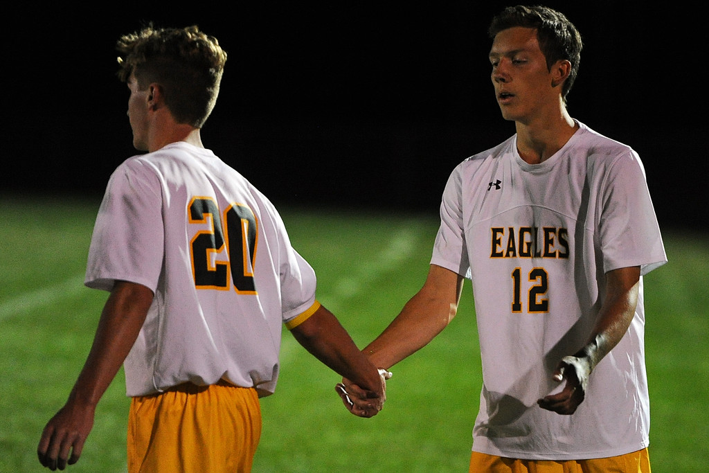 . Thompson Valley\'s Benjamin Lane (12) high-fives Logan Brian after a game Thursday, Sept. 20, 2018 at Berthoud High School. (Sean Star/Loveland Reporter-Herald)