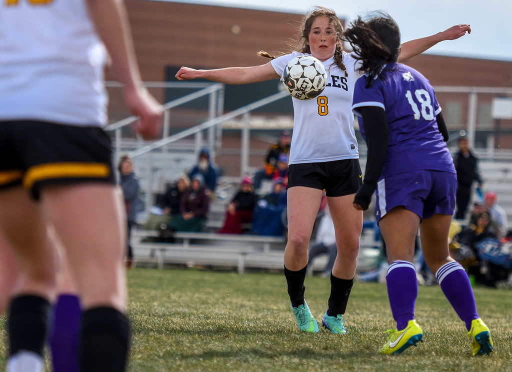 . Thompson Valley\'s Arden McCauley plays a ball off her chest against crosstown rival Mountain View on Tuesday April 17, 2018 at MVHS. (Cris Tiller / Loveland Reporter-Herald)