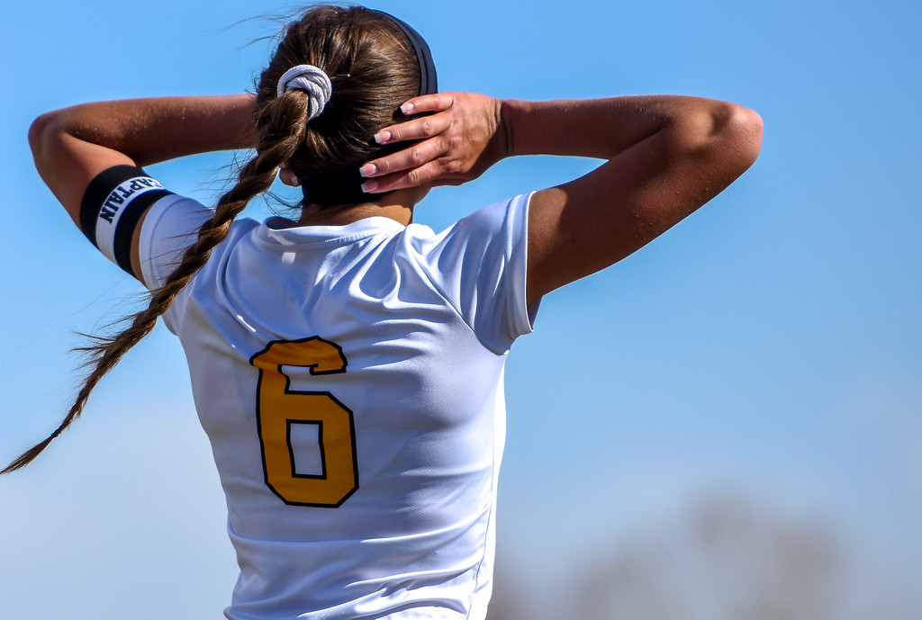 . Thompson Valley\'s Kaili Campbell reacts after missing a shot in the wind against crosstown rival Mountain View on Tuesday April 17, 2018 at MVHS. (Cris Tiller / Loveland Reporter-Herald)