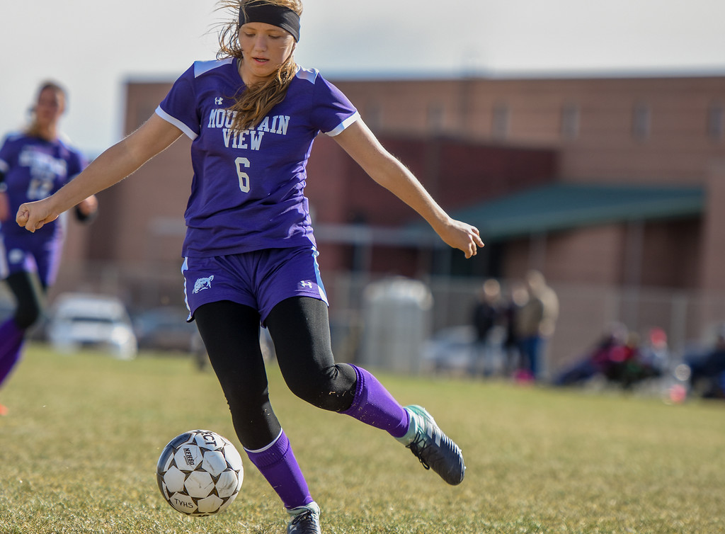 . Mountain View\'s Peyton Oleson plays the ball against crosstown rival Thompson Valley on Tuesday April 17, 2018 at MVHS. (Cris Tiller / Loveland Reporter-Herald)
