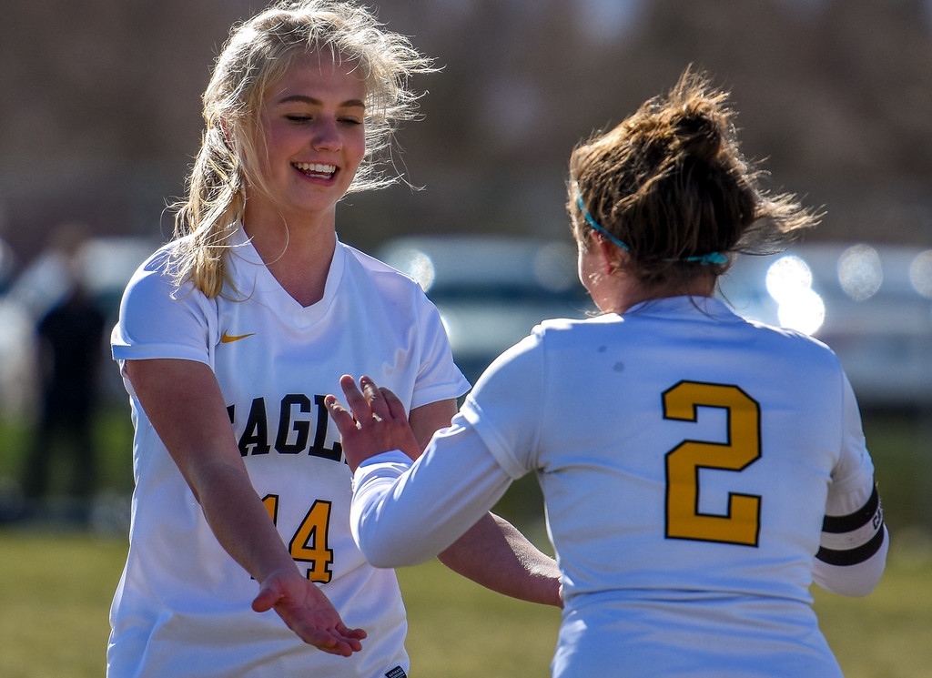 . Thompson Valley\'s Novi Briggs receives a high five after scoring against crosstown rival Mountain View on Tuesday April 17, 2018 at MVHS. (Cris Tiller / Loveland Reporter-Herald)