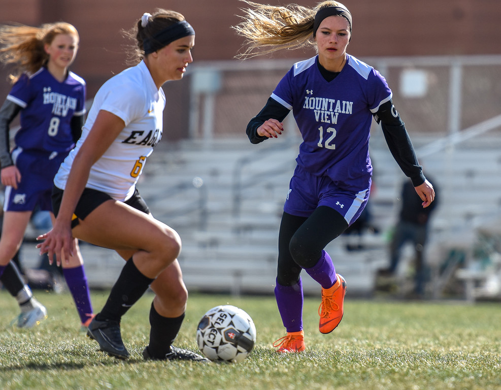 . Mountain View\'s Shelby Olson (12) eyes the ball against crosstown rival Thompson Valley on Tuesday April 17, 2018 at MVHS. (Cris Tiller / Loveland Reporter-Herald)