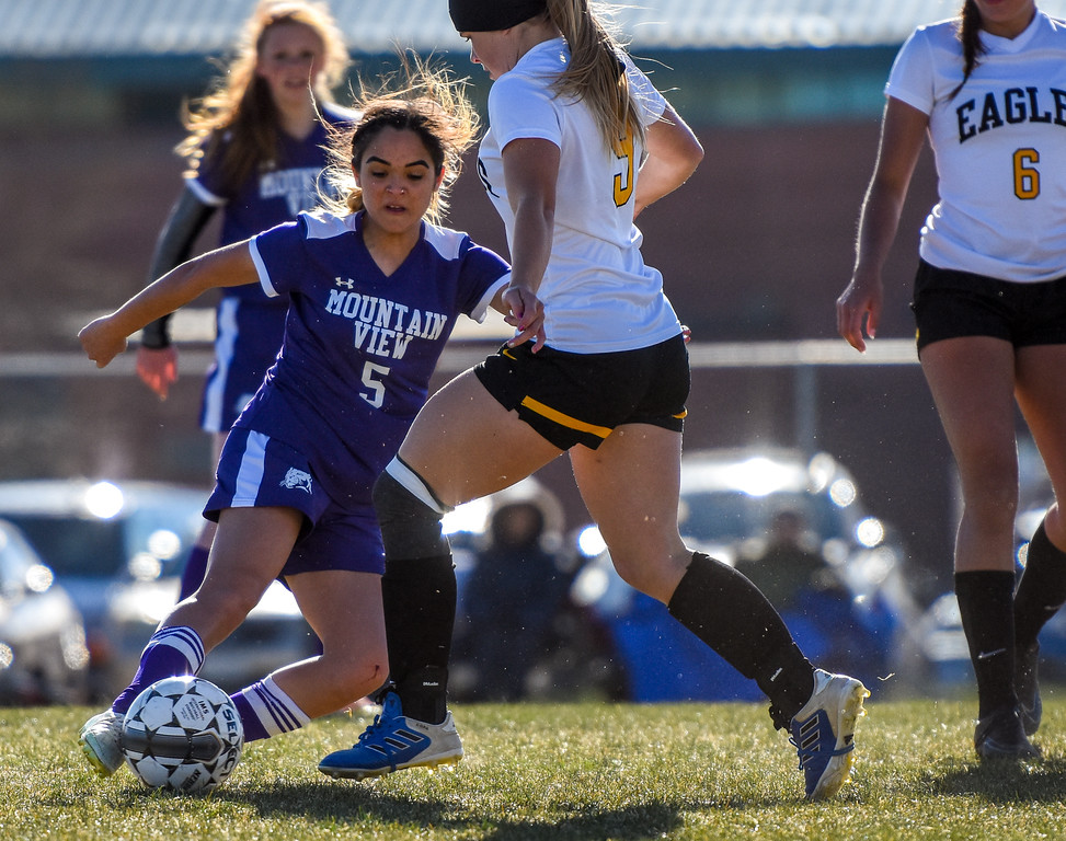 . Mountain View\'s Alyssa Perez (5) goes in for a tackle against crosstown rival Thompson Valley on Tuesday April 17, 2018 at MVHS. (Cris Tiller / Loveland Reporter-Herald)