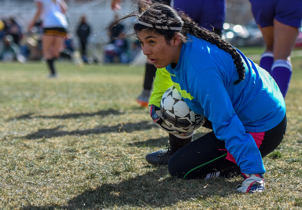 . Mountain View keeper Beatriz Lopes makes a save against crosstown rival Thompson Valley on Tuesday April 17, 2018 at MVHS. (Cris Tiller / Loveland Reporter-Herald)