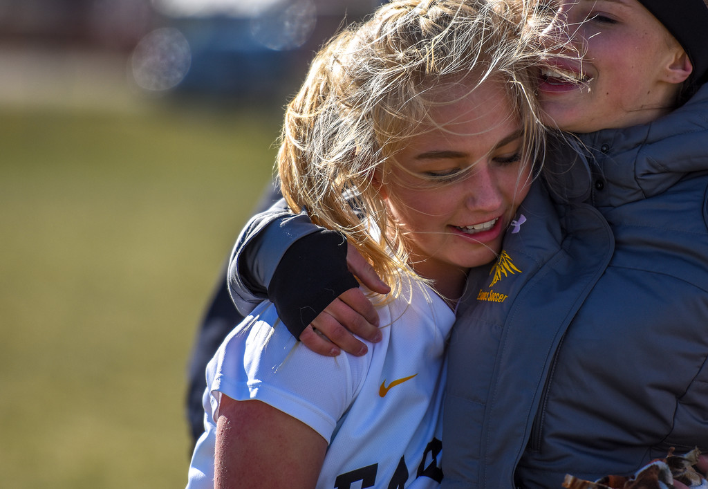 . Thompson Valley\'s Novi Briggs receives a hug after scoring against crosstown rival Mountain View on Tuesday April 17, 2018 at MVHS. (Cris Tiller / Loveland Reporter-Herald)