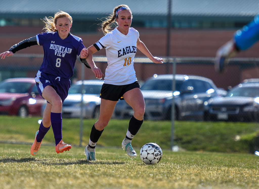 . Thompson Valley\'s Kahrena Thompson (10) streaks down the touchline in front of Mountain View defender Kaylee McKie (8)  on Tuesday April 17, 2018 at MVHS. (Cris Tiller / Loveland Reporter-Herald)