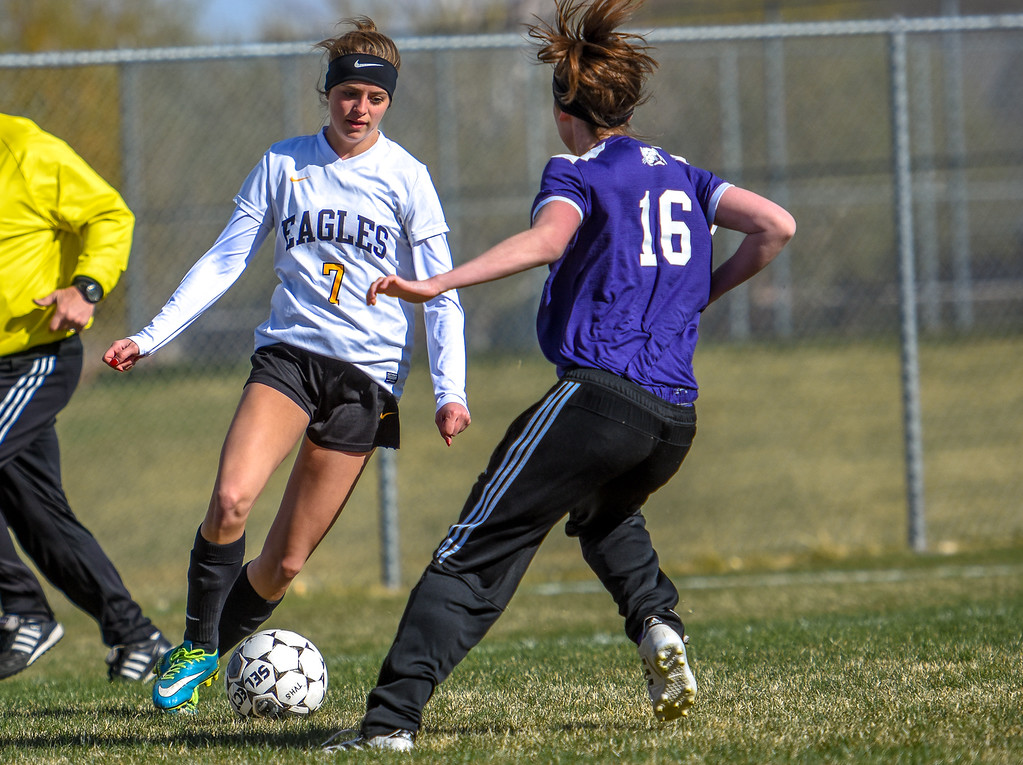 . Thompson Valley\'s Emily Dawes makes a move on Mountain View defender Kaylee McKie (16)  on Tuesday April 17, 2018 at MVHS. (Cris Tiller / Loveland Reporter-Herald)