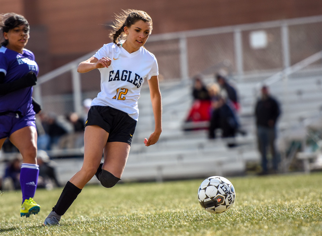 . Thompson Valley\'s Elizabeth Bryson (12) chases a through ball against crosstown rival Mountain View on Tuesday April 17, 2018 at MVHS. (Cris Tiller / Loveland Reporter-Herald)