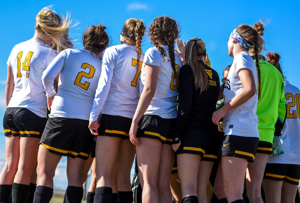 . Thompson Valley girls soccer breaks a huddle against crosstown rival Mountain View on Tuesday April 17, 2018 at MVHS. (Cris Tiller / Loveland Reporter-Herald)