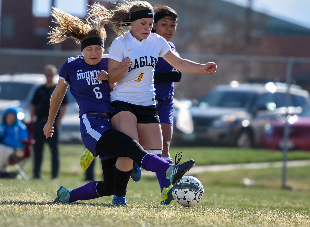 . Mountain View\'s Peyton Oleson (6) goes in for a tackle against Thompson Valley\'s Maddy Kaminky on Tuesday April 17, 2018 at MVHS. (Cris Tiller / Loveland Reporter-Herald)