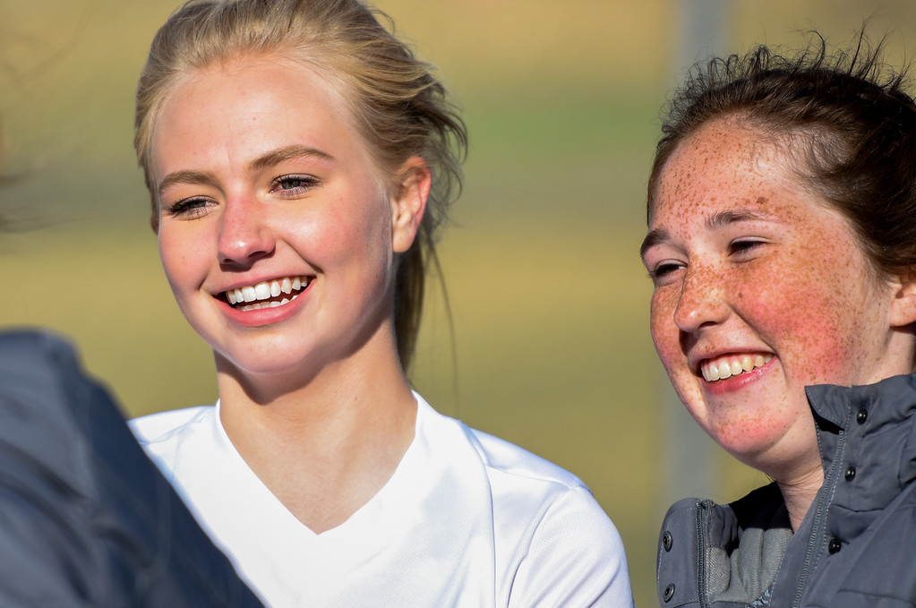 . Thompson Valley\'s Novi Briggs, left, and Arden McCauley joke around during halftime against crosstown rival Mountain View on Tuesday April 17, 2018 at MVHS. (Cris Tiller / Loveland Reporter-Herald)