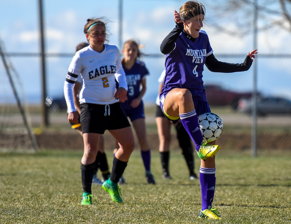 . Mountain View\'s Kennedy Neustel (4) plays the ball against crosstown rival Thompson Valley on Tuesday April 17, 2018 at MVHS. (Cris Tiller / Loveland Reporter-Herald)