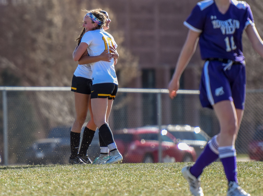 . Thompson Valley\'s Kahrena Thompson (10) and teammate Kaili Campbell hug after scoring against crosstown rival Mountain View on Tuesday April 17, 2018 at MVHS. (Cris Tiller / Loveland Reporter-Herald)
