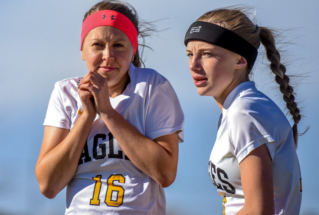 . Thompson Valley\'s Samantha Bryson (16) tries to stay warm waiting to sub in against crosstown rival Mountain View on Tuesday April 17, 2018 at MVHS. (Cris Tiller / Loveland Reporter-Herald)