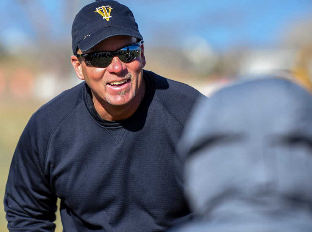 . Thompson Valley head coach Randy Chase laughs withhis players at halftime against crosstown rival Mountain View on Tuesday April 17, 2018 at MVHS. (Cris Tiller / Loveland Reporter-Herald)