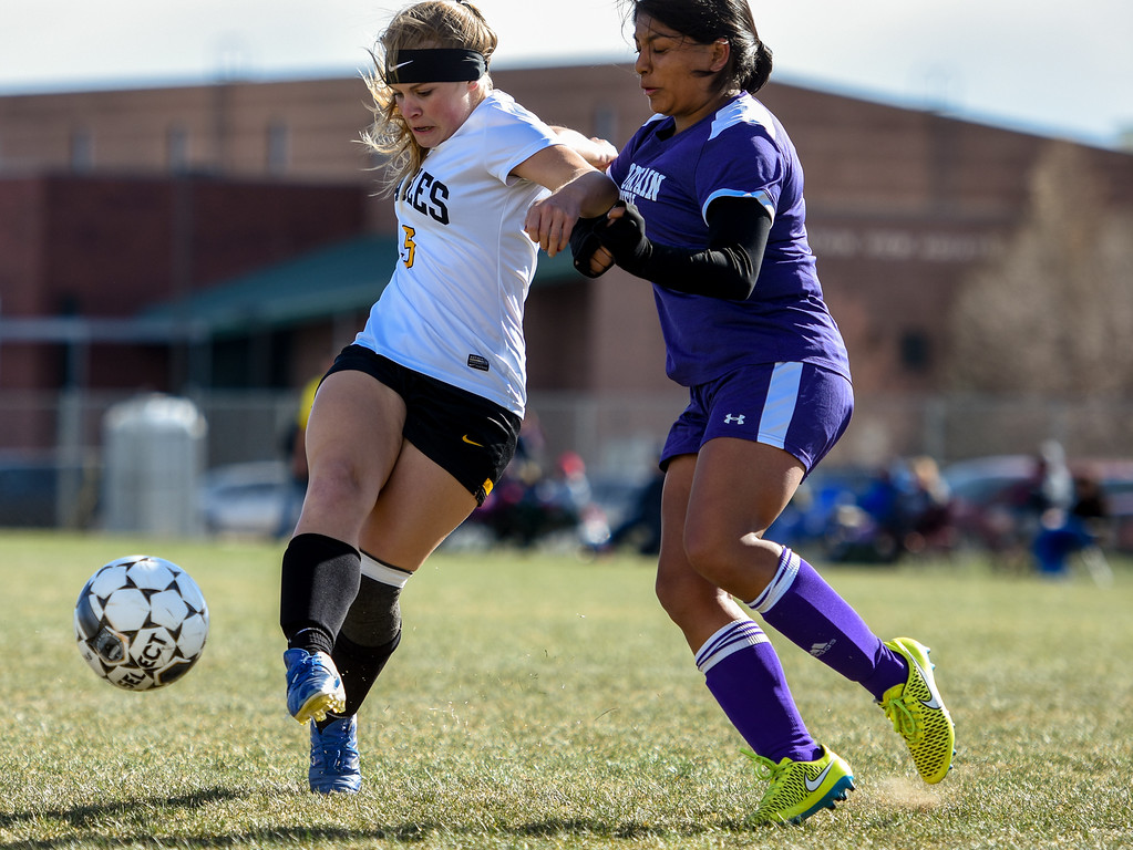 . Thompson Valley\'s Maddy Kaminky, left, takes a shot in front of the defense of Mountain View\'s Martha Lopez Gomez on Tuesday April 17, 2018 at MVHS. (Cris Tiller / Loveland Reporter-Herald)