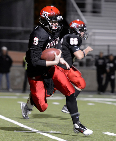 """Fairview vs Pomona Football005.JPG Fairview High School quarterback Anders Hill rushes the ball during a game against Pomona High School on Friday, Oct. 19, at Boulder High School. For more photos of the game go to  <a href=""""http://www.dailycamera.com"""">http://www.dailycamera.com</a><br /> Jeremy Papasso/ Camera"""