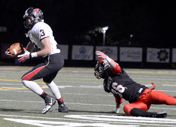 """Fairview vs Pomona Football010.JPG Fairview High School's Aaron MacArthur misses a tackle on Mitch Colin during a game against Pomona High School on Friday, Oct. 19, at Boulder High School. For more photos of the game go to  <a href=""""http://www.dailycamera.com"""">http://www.dailycamera.com</a><br /> Jeremy Papasso/ Camera"""