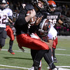 "Fairview vs Pomona Football006.JPG Fairview High School quarterback Anders Hill takes a big hit from Deshon Mayes during a game against Pomona High School on Friday, Oct. 19, at Boulder High School. For more photos of the game go to  <a href=""http://www.dailycamera.com"">http://www.dailycamera.com</a><br /> Jeremy Papasso/ Camera"