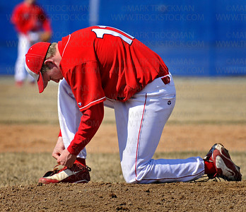 Red Knights pitcher Brendan Rooney takes a break in the second inning to tie his shoe on the mound at Wayzata Saturday, April 11, 2009 in Plymouth.  Benilde-St. Margaret's beat Wayzata 6-4.