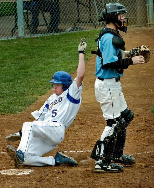 Trojan outfielder Caleb Reesnes beats the throw to home plate in the bottom of the first inning to score Wayzata's first run against the Jaguars June 3 at Braemar Fields in Edina.  The Jaguars deseated the Trojans 3-2 to end Wayzata's bid for the 2008 state tournament.