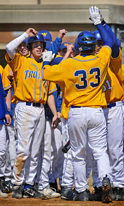 Wayzata's Zack Trygstad (33) is congratulated by his varsity teammates after smacking a home-run in the third inning against Benilde-St. Margaret's in Plymouth Saturday, April 11, 2009.  Wayzata lost to the Red Knights 6-4.