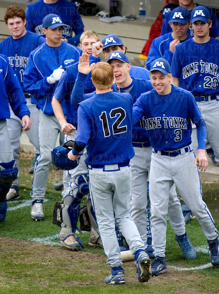 Minnetonka senior shortstop Tim Mettert, center, is congratulated by teammates after Metter's two-run blast in the top of the third to make it 9-1 against Hopkins.  The Skippers went on to beat the Royals 12-2 Thursday, May at Hopkins HS.