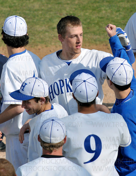 Royals senior Christopher Anderson is congratulated by teammates after hitting his first of three home-runs against Benilde Thursday, April 30 in Minnetonka.