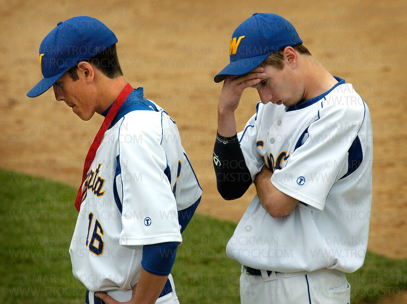 Wayzata's Billy Soule, left, and Peter Kelly feel their 3-2, Section 6-3A loss to Jefferson sink in during the awards ceremony after the game Tuesday, June 3 in Edina.