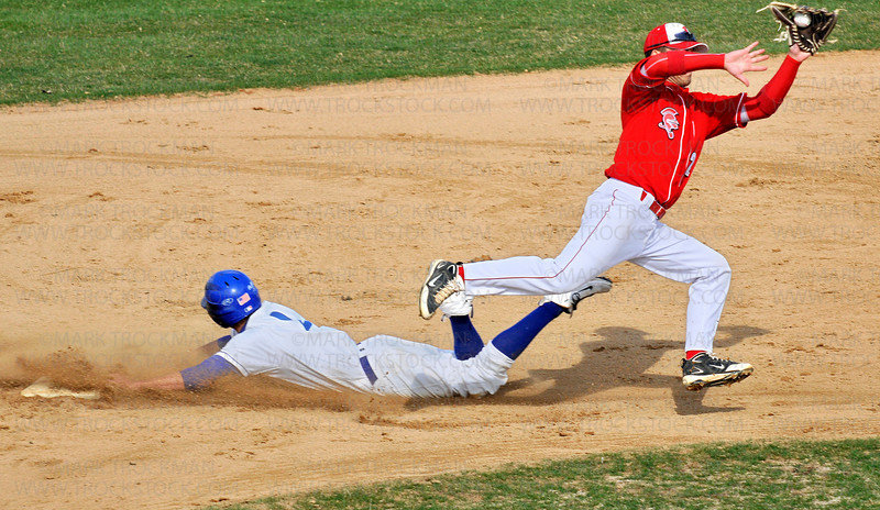 Hopkins' Alex Powell slides safely into second on an early-inning steal while B-SM's Kevin Kosiek fields a wide throw Thursday, April 30 in Minnetonka.