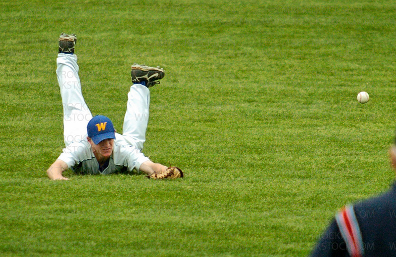 On the last play of the game Wayzata's Lucas Steinbach, on ground, did all he could in diving for a line drive but came up short Tuesday, June 3, in Edina.  The Trojans fell to the Jaguars 3-2.