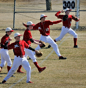 Mound-Westonka players take throwing practice before their game against Osseo in Minnetrista Thursday, April 19.  The White Hawks were blanked by Osseo 7-0.