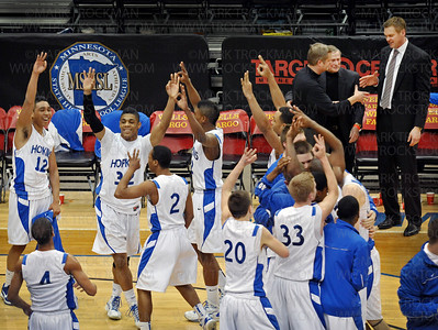 Three-peat!  The 2011 Hopkins boys basketball team and coaches clear the bench in celebration after clinching their third Class 4-A Minnesota state championship in as many years Saturday, Mar. 26, at Target Center in Minneapolis.  The Royals defeated Eden Prairie 64-52.