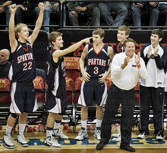The Orono bench gets ready to celebrate their 85-76 state Class 4-A championship win against Columbia Heights at Target Center Saturday, Mar. 26, in Minneapolis.